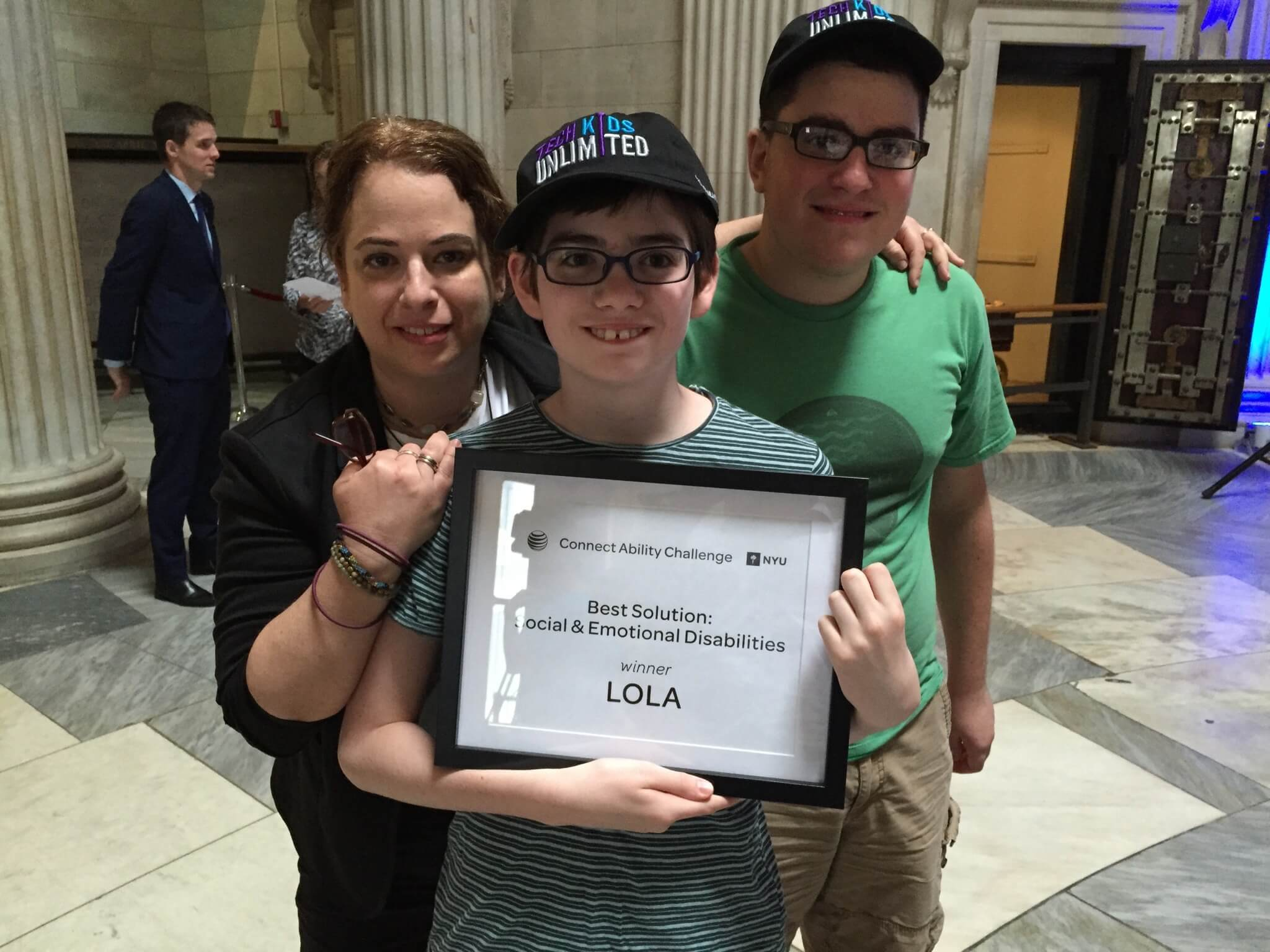 A photo of Beth, Jack and Seth receiving the Connect Ability Challenge award
